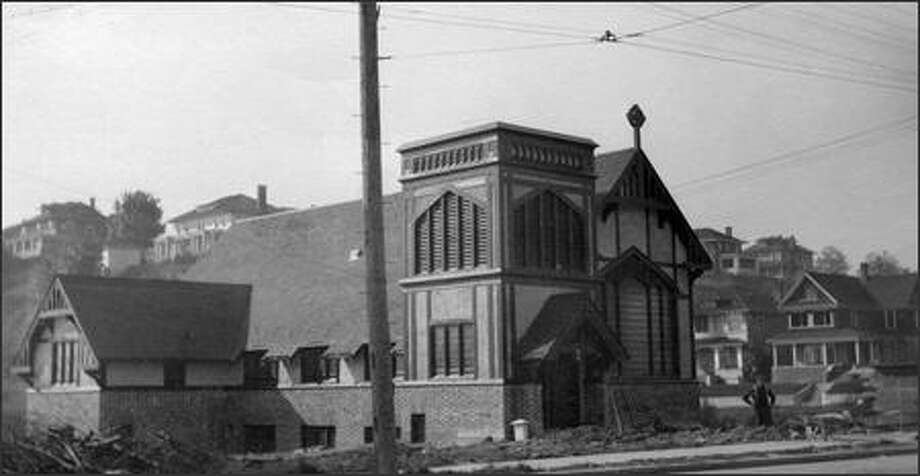 The Church of the Epiphany in the Capitol Hill neighborhood was declared a historic Seattle landmark in 1978. The church is seen in 1911, the year it moved to its current location. Photo: / P-I File