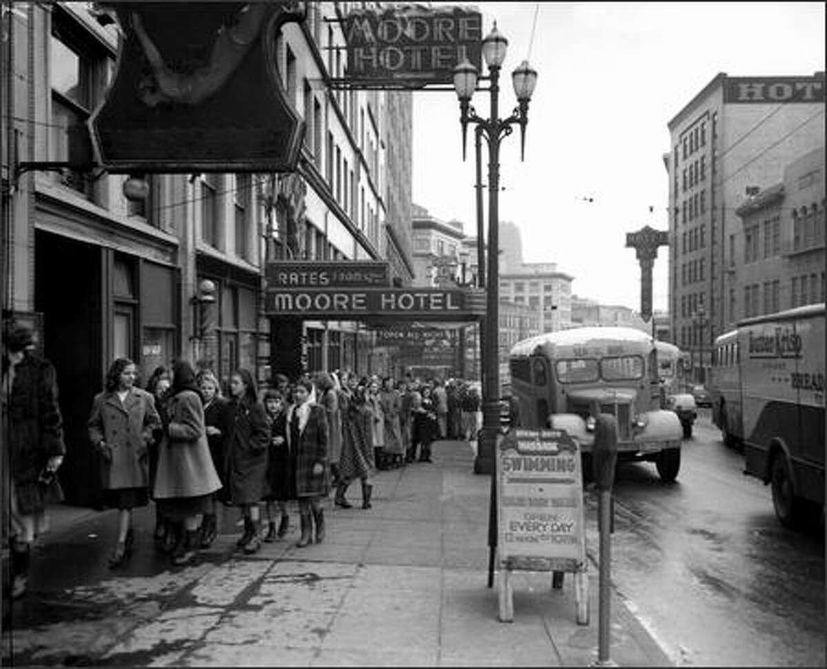 1948: Schoolchildren line up for the symphony at the Moore Theatre, downtown on Second Avenue.