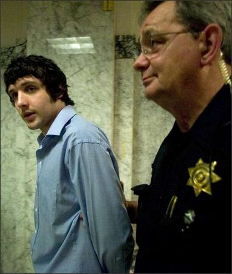 Nikolay Sloboda is escorted back to the King County Jail on Friday. A King County Superior Court jury found Sloboda guilty of second-degree murder. Sloboda fatally stabbed Michael Behm, the son of a King County sheriff's deputy, on March 7, 2004. Photo: Jim Bryant/Seattle Post-Intelligencer