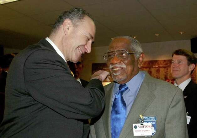 Sen. Charles Schumer, D-N.Y., left, congratulates Herman A. Johnson at the Pentagon Thursday, Feb. 13, 2003, prior to Johnson accepting the Distinguised Service Cross on behalf of his late father, Sgt. Henry Johnson of Albany, N. Y., for heroism in World War I. (AP Photo/Dennis Cook) Photo: DENNIS COOK / j=0321_henryjohnson