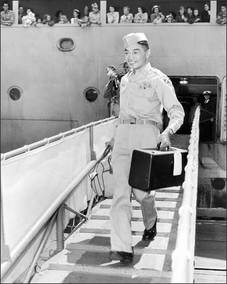Sgt. Fred Y. Furukawa is the first man down the gangplank from a ship returning home from South Korea. Photo: / P-I File