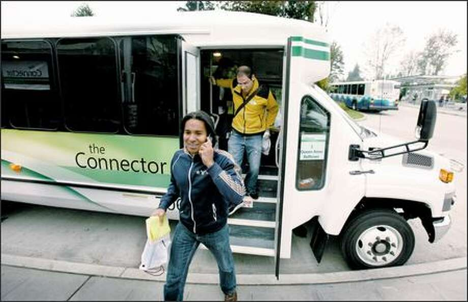 Software engineer Jaspreet Bakshi arrives at the Overlake Transit Center at Microsoft's Redmond campus Monday, the first day of service for the new bus line. Photo: Paul Joseph Brown/Seattle Post-Intelligencer