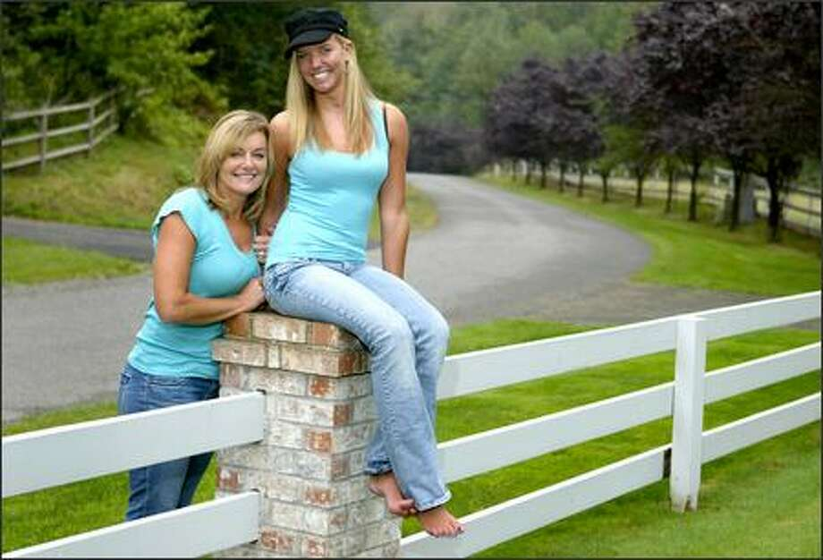 Summer Thompson and her mother Sherri at home in Issaquah. Summer, once a rising volleyball star at Liberty High, nearly died in a car wreck last year. Photo: Joshua Trujillo/Seattle Post-Intelligencer