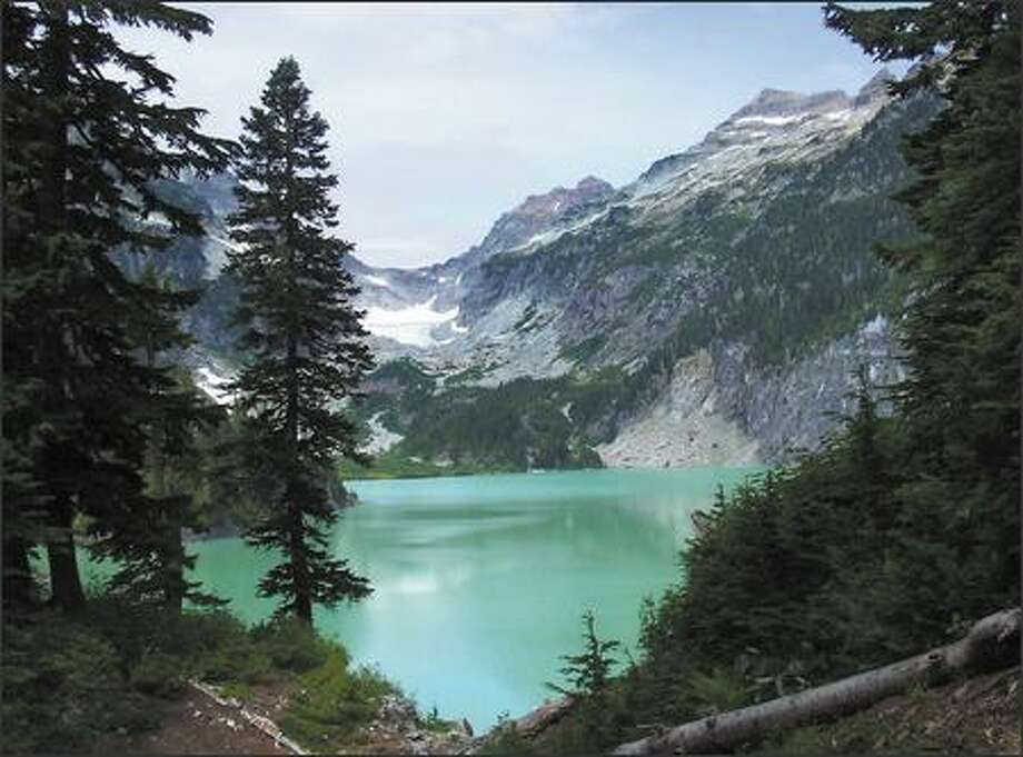 The greenish color of Blanca Lake is produced by silt washing into the lake from the Columbia Glacier, which can be seen in the distance. Photo: Karen Sykes/Special To The Post-Intelligencer