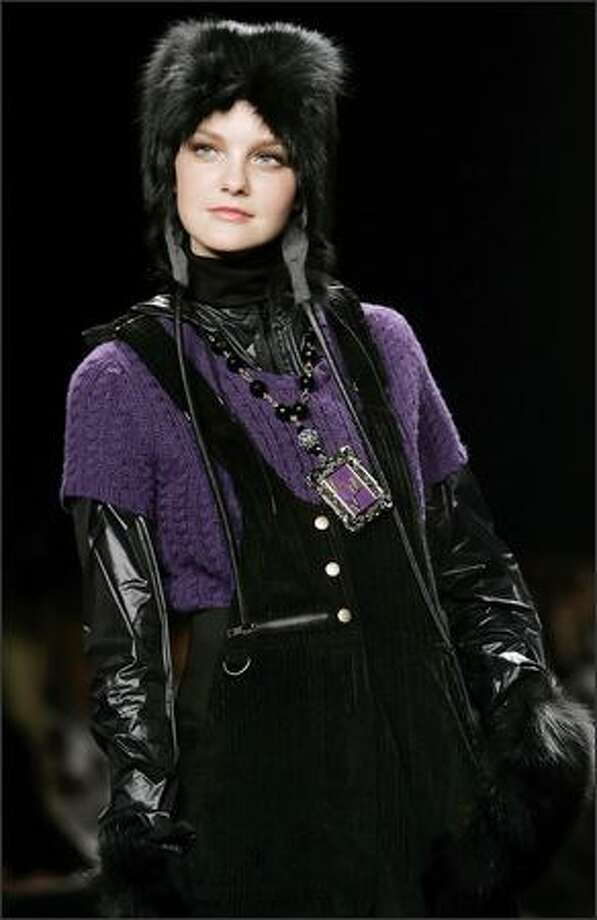 "Purple ""looks fabulous in knitwear,"" such as this sweater, and pairs well with black or gray. Photo: / Associated Press"