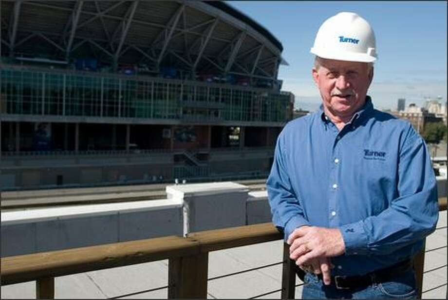 Former University of Washington football coach Jim Lambright stands near Qwest Field, which was built by the company he works for as a consultant. Photo: Jim Bryant/Seattle Post-Intelligencer
