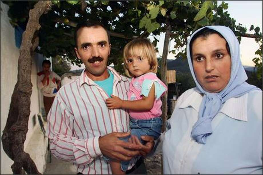 Three-year-old Bouchra Ahmed Ben Aissa is photographed with her father, Ahmed Mohamed Ben Aissa, and her mother, Hafida Mohamed Akachar, at their home in Zinat, Morocco. Bouchra is believed to be the girl who was photographed by a Spanish tourist who thought she might be missing 3-year-old Madeleine McCann of Britain. Photo: / Associated Press