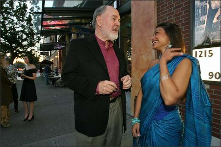 Executive Producer David Skinner talks to Indian actress and star Ayesha Dharker at the premiere of the film outside Majestic Bay Theatres in Ballard on Wednesday. Photo: Mike Urban/Seattle Post-Intelligencer
