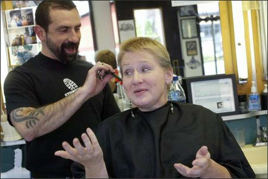 Jeanne Sather with her hairdresser, Chez Sanchez, at the Barber Shop in Seattle. Photo: Karen Ducey/Seattle Post-Intelligencer