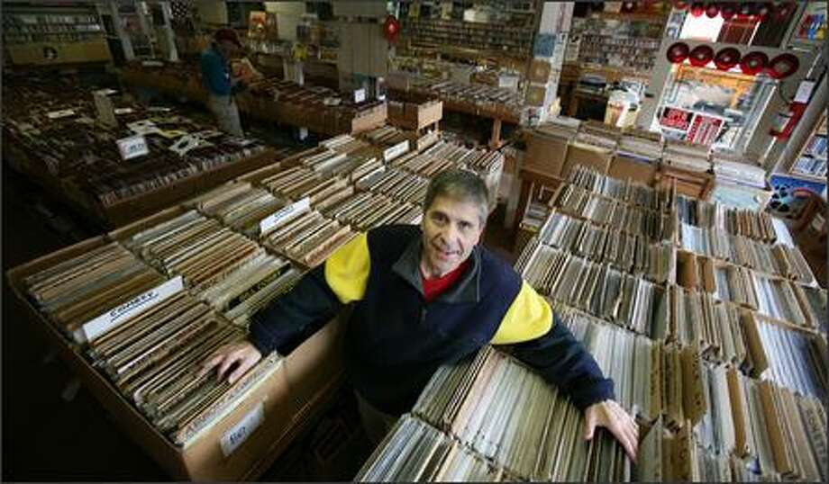 Dean Silverstone displays boxes and boxes of albums at Golden Oldies in Wallingford -- which has been called one of the best record stores in America. Photo: Paul Joseph Brown/Seattle Post-Intelligencer