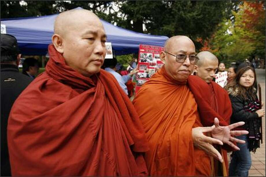Venerable Ashin Kovida, middle, with Venerable Sokkinda, left, and Venerable Koallan, speak Monday during a protest at the University of Washington about his fellow Buddhist monks from Myanmar. Photo: Grant M. Haller/Seattle Post-Intelligencer