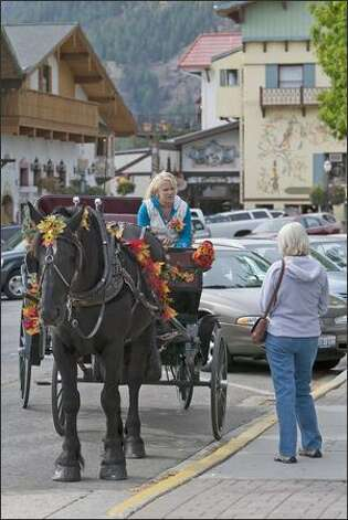 Joker, a 10-year-old Percheron, and driver Cyndi Nunn provide rides around town. Photo: Grant M. Haller/Seattle Post-Intelligencer