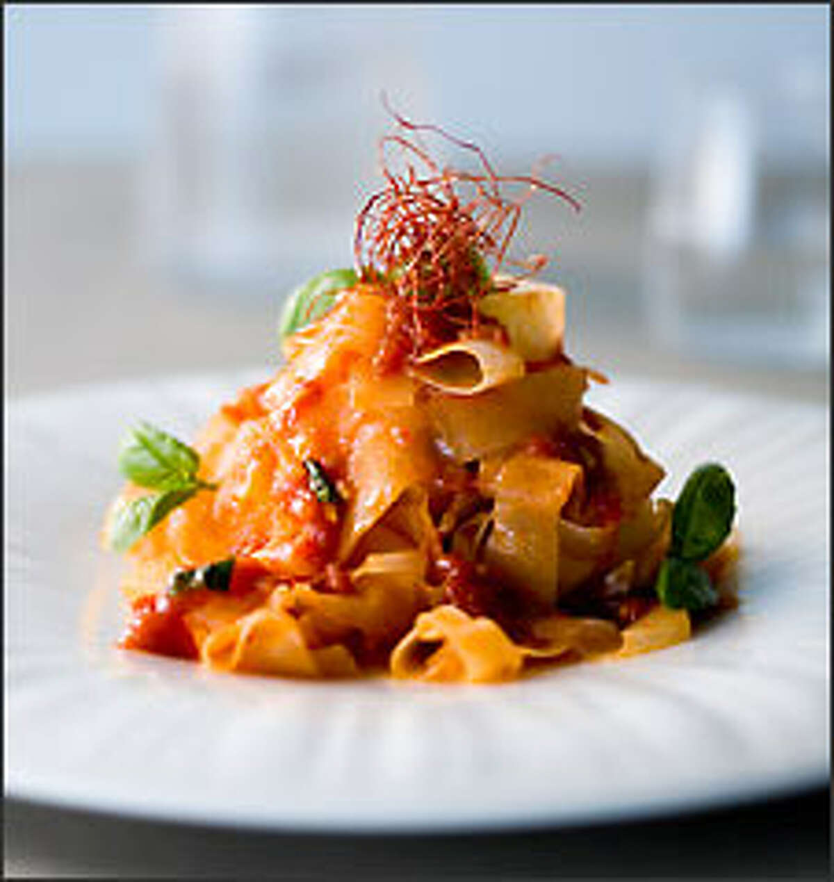 """Morimoto spent years honing classic techniques, but now fuses them with creative appearances, tastes and textures. Daikon """"fettuccine,"""" above, makes a visual pun on Italian food, pairing peeled ribbons of the radish with a quick tomato-basil sauce."""