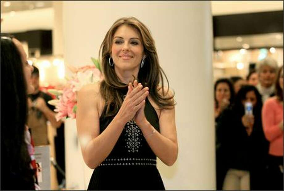 Model and actress Elizabeth Hurley makes an appearance at Nordstrom in downtown Seattle on Wednesday as a spokesperson for Breast Cancer Awareness Month and to promote Estee Lauder merchandise. Photo: Dan DeLong/Seattle Post-Intelligencer