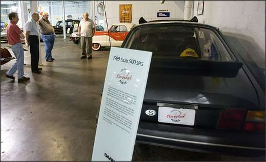 Patrons look at Peter Gilbert's 1989 Saab 900 SPG at the Wisconsin Automotive Museum in Hartford. The car has been driven more than 1 million miles over 17 years with the same engine. Photo: / Associated Press