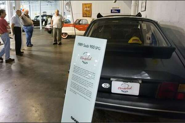 Patrons look at Peter Gilbert's 1989 Saab 900 SPG at the Wisconsin Automotive Museum in Hartford. The car has been driven more than 1 million miles over 17 years with the same engine.