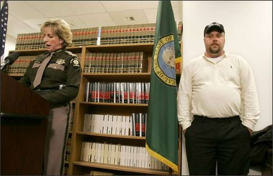 Tom Rider listens to King County Sheriff Sue Rahr during a news conference at the Sheriff's Office on Thursday, in which Rahr apologized for some of the ways Rider was treated by the Sheriff's Office while his wife Tanya was missing. Photo: Meryl Schenker/Seattle Post-Intelligencer