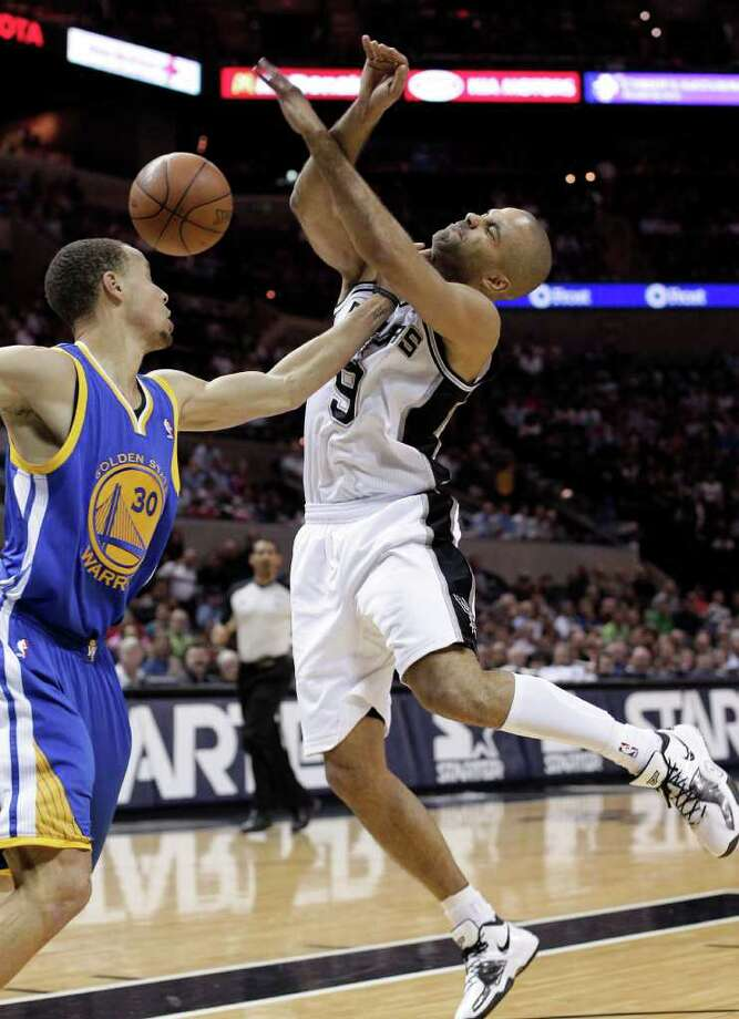 San Antonio Spurs' Tony Parker (9), of France, is fouled by  Golden State Warriors' Stephen Curry (30) during the first quarter of an NBA basketball game, Monday, March 21, 2011, in San Antonio. Photo: AP