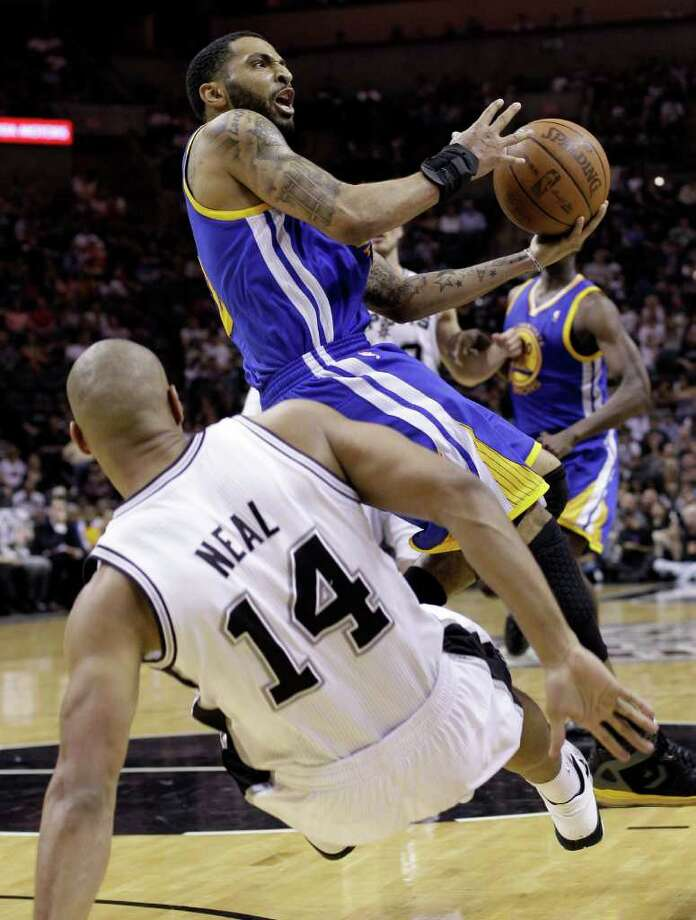 Golden State Warriors' Acie Law collides with San Antonio Spurs' Gary Neal (14) during the third quarter of an NBA basketball game Monday, March 21, 2011 in San Antonio. San Antonio won 111-96. Photo: AP
