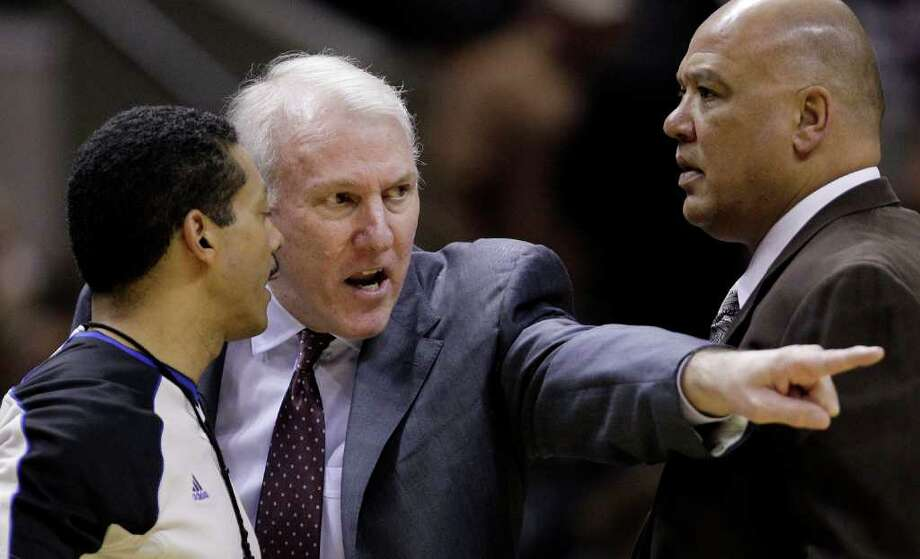 San Antonio Spurs coach Gregg Popovich, center, argues a call with official Bill Kennedy, left, during the third quarter of an NBA basketball game, Monday, March 21, 2011, in San Antonio. San Antonio won 111-96. Spurs assistant coach Don Newman is at right. Photo: AP