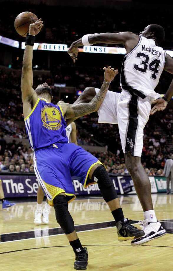 San Antonio Spurs' Antonio McDyess (34) rejects a shot by Golden State Warriors' Acie Law (2) during the fourth quarter of an NBA basketball game Monday, March 21, 2011, in San Antonio. San Antonio won 111-96. Photo: AP
