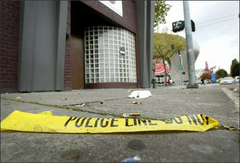 Police tape lies amid cigarette butts and other garbage on the sidewalk in front of the Level 5 nightclub Saturday afternoon. Photo: Joshua Trujillo/Seattle Post-Intelligencer