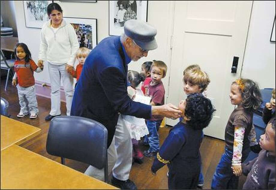 El Centro Executive Director Roberto Maestas greets preschool children. He helped found the organization after a sit-in in 1972. Photo: Gilbert W. Arias/Seattle Post-Intelligencer