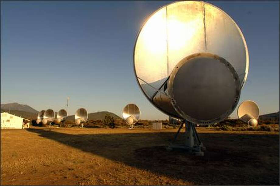 Radio dishes sprout across the high desert landscape of Hat Creek, Calif., representing the first phase of Paul Allen's radio telescope network.  (Photo courtesy of SETI and the University of California, Berkeley) Photo: /
