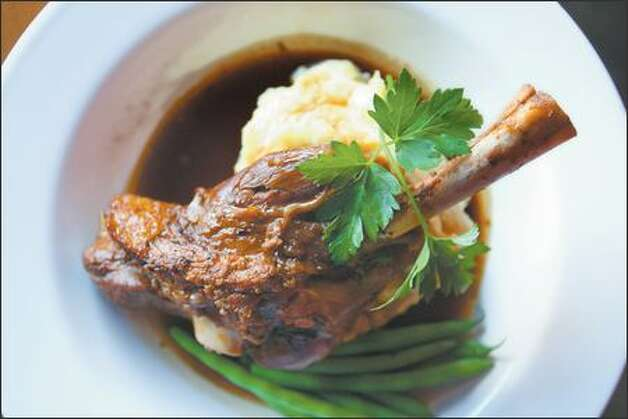 Hills' Food and Wine beckons with braised lamb shank in red wine demi-glace, green beans and Yukon gold mashed potatoes. Photo: Scott Eklund/P-I