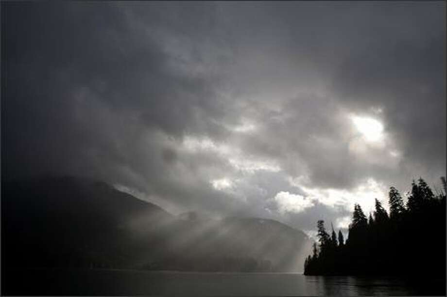 Sunlight streams through a break in the storm clouds over the lake. Photo: Stephen Brashear/Special To The P-I