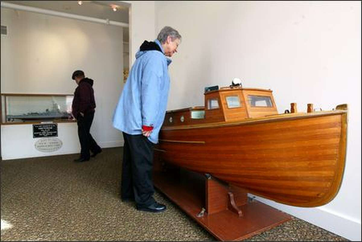 At the Bremerton Naval Museum, Laura Logan of Bremerton checks out a replica of a 38-foot picket boat.