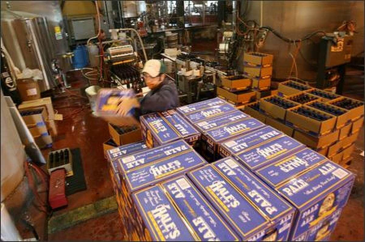 Brandon Ballard puts the final case of Hale's Pale Ale onto a pallet at the brewery in Ballard.