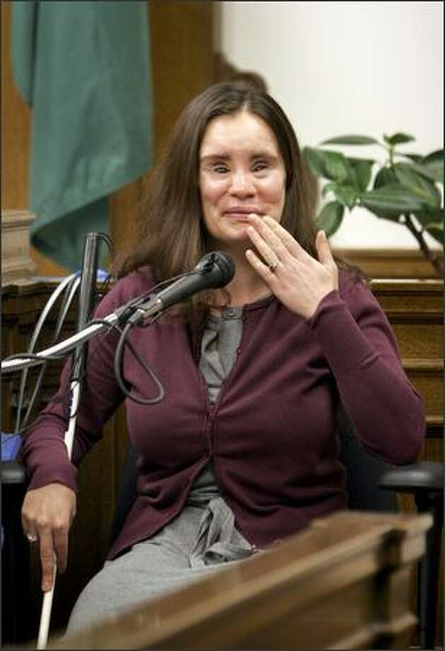 Near the end of her testimony Wednesday in King County Court, Maria Federici starts to cry as she recounts the story of how her mother was told that she was alive at the same time as her service dog was born. The February 2004 accident shattered bones in Federici's face and severed arteries, and she was left permanently blind. Photo: Meryl Schenker/Seattle Post-Intelligencer