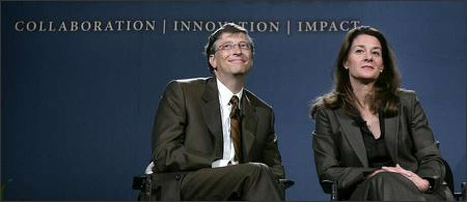 Bill and Melinda Gates listen to a question at the forum on malaria on Wednesday in Seattle. Photo: / Associated Press