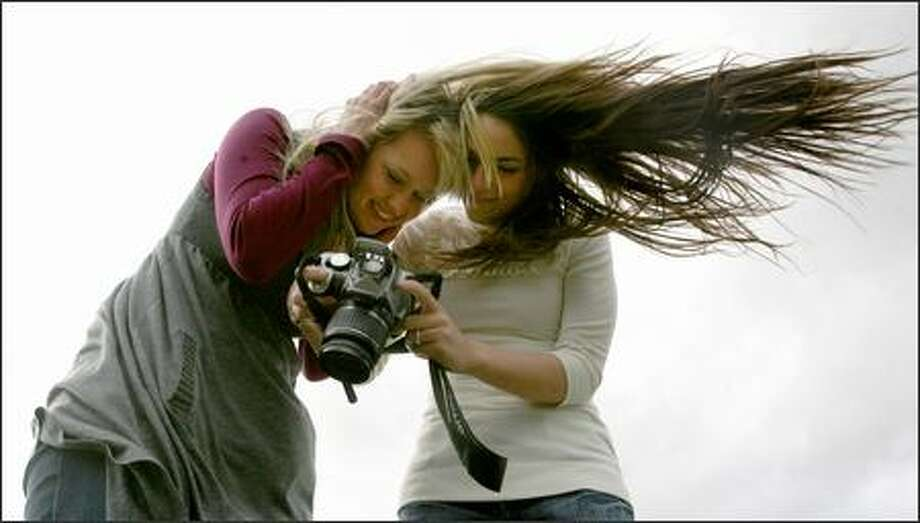 Jessica Bosarge (left), 20, of Seattle, and Jennifer Ashburn, 19, of Puyallup visited Gas Works Park Thursday and got their money's worth as the wind blowing off Lake Union made for some memorable pictures. Photo: Scott Eklund/Seattle Post-Intelligencer
