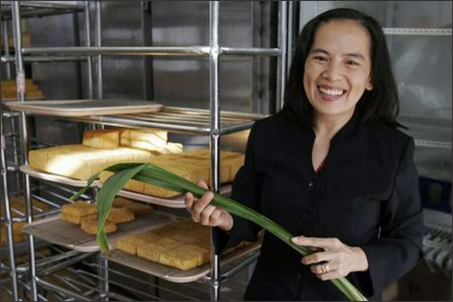 Thanh Nga Nguyen, owner of the Chuminh Tofu Factory, holds a pandan leaf used to flavor one of her soy milk products. Photo: Meryl Schenker/Seattle Post-Intelligencer