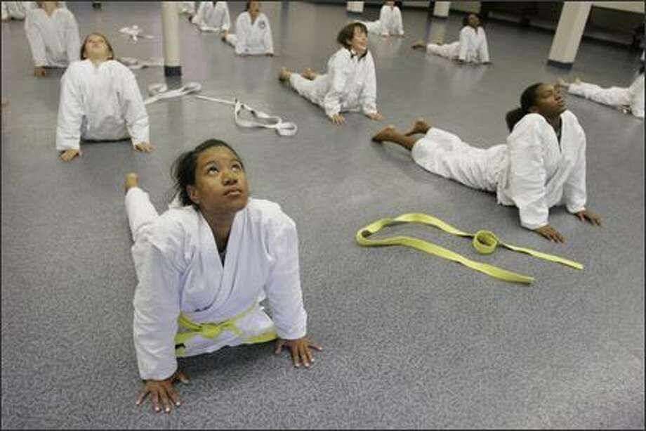 Eighth-grader Safiya King does yoga with her class at Lake Washington Girls Middle School. Photo: Meryl Schenker/Seattle Post-Intelligencer