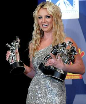 ** FILE ** In this Sept. 7, 2008 file photo, Britney Spears poses with her awards backstage at the 2008 MTV Video Music Awards in Los Angeles. Photo: Chris Pizzello, AP / AP