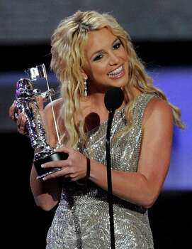 Britney Spears accepts the award for best pop video at the MTV Music Awards in Paramount Pictures Studios in Los Angeles on Sunday, Sept. 7, 2008. Photo: Kevork Djansezian, AP / AP