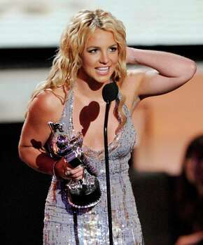 Britney Spears accepts the award for best female video at the MTV Music Awards in Paramount Pictures Studios in Los Angeles on Sunday, Sept. 7, 2008. Photo: Kevork Djansezian, AP / AP