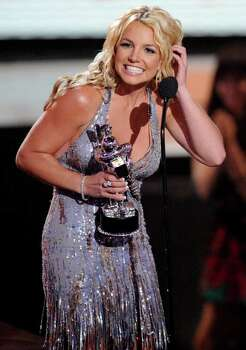 "Singer Britney Spears accepts the award for best video of the year for ""Piece of Me"" at the MTV Music Awards in Paramount Pictures Studios in Los Angeles on Sunday, Sept. 7, 2008. Photo: Kevork Djansezian, AP / AP"