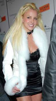 ** FILE **Singer Britney Spears poses on the press line at the Scandinavian Style Mansion party in Los Angeles in this Dec. 1, 2007 file photo. A state appeals court on Monday dismissed an attorney's challenge to the conservatorship that gives Britney Spears' father control over much of her life. Photo: Dan Steinberg, AP / R-STEINBERG