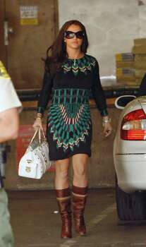 "** FILE ** Britney Spears arrives at court for a hearing to work out custody arrangements with her ex-husband Kevin Federline for their two young sons in this Oct. 26, 2007, file photo in Los Angeles. Spears' latest album ""Blackout"" hits stores Tuesday, Oct. 29, as the 25-year-old pop star flounders in a boatload of bad publicity. But despite her panty-less pictures, parenting problems and nonstop partying, fans and critics expect the album to succeed. Photo: Chris Polk, AP / R-POLK"