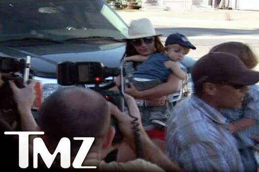 "Britney Spears is shown in this frame grab from video courtesy of website TMZ.com as she carries her son Sean Preston Federline as an assistant carries her other son Jayden James Federline, as Spears leaves a restaurant in Malibu, California September 30, 2007. Los Angeles County Superior Court Judge Scott Gordon issued an order October 1, 2007 stating that Kevin Federline, the boys' father, ""is to retain physical custody of the minor children on Wednesday, October 3, 2007 at 12:00 PM until further order of the court.""    REUTERS/Courtesy TMZ.COM/Handout  (UNITED STATES)   NO CROPPING OF PHOTO PERMITTED TMZ LOGO  MUST REMAIN IN PHOTO  USAGE UNTIL OCTOBER 8, 2007 MANDATED BY SOURCE.  EDITORIAL USE ONLY. NOT FOR SALE FOR MARKETING OR ADVERTISING CAMPAIGNS. NO ARCHIVES. NO SALES. Photo: HO, REUTERS / X80001"