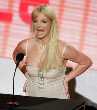 **FILE**Britney Spears takes the stage to present at the  American Music Awards in Los Angeles, on   Nov. 21, 2006. Mexican TV and print media have published unflattering photos of  Spears that celebrity Web site TMZ says were taken in Puerto Vallarta last weekend. Photo: Mark J. Terrill, AP / AP