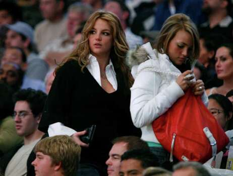 Britney Spears, left, leaves just before half time during the Washington Wizards and the Los Angeles Lakers NBA basketball game in Los Angeles, Sunday, Dec. 17, 2006. Photo: Mark Avery, AP / AP