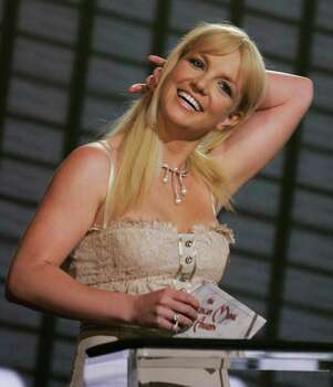 Britney Spears takes the stage to present an award at the 2006 American Music Awards in Los Angeles, on Tuesday, Nov. 21, 2006. Photo: Kevork Djansezian, AP / AP