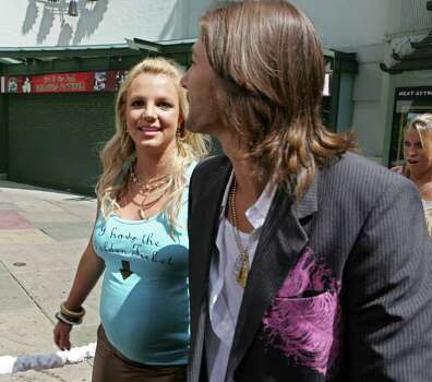 "Singer Britney Spears, left, and husband Kevin Federline, right, arrive for the world premiere of Warner Bros. Pictures' ""Charlie and the Chocolate Factory,"" Sunday, July 10, 2005, in the Hollywood section of Los Angeles. Photo: DANNY MOLOSHOK, AP / AP"