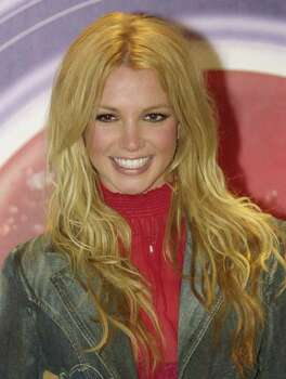 ** FILE ** Pop star Britney Spears poses for photographers July 26, 2002, in a Mexico City file photo. Spears has revealed what might be Hollywood's worst-kept secret: She's pregnant. Photo: JOSE LUIS MAGANA, AP / AP