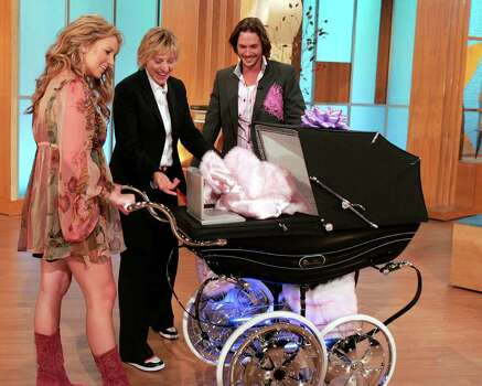 "In this photo released by Warner Bros., talk show host Ellen DeGeneres, center, surprises parents-to-be Britney Spears, left, and Kevin Federline with a carriage customized especially for them with neon lights, spinners and a Sony DVD player, during a taping of ""The Ellen DeGeneres Show"" in Burbank, Calif., on Monday, May 16, 2005. The interview with Britney and Kevin airs Tuesday. Photo: CHRIS POLK, AP / WARNER BROS"